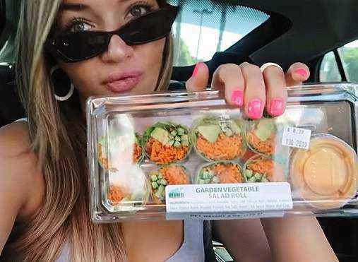 What does Hollywood model Erika Costell eat on a typical day in order to stay fit? On the go she has a salad bowl from Whole Foods.