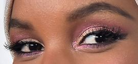 Picture of Halima Aden eyeliner, eyeshadow, and eyelash enhancements