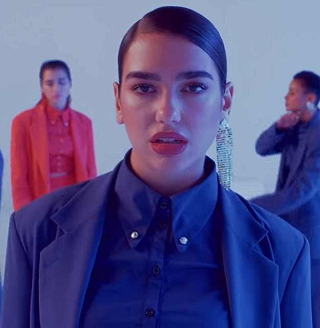 Images of Dua Lipa from the music video IDGAF