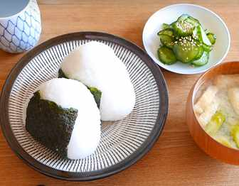 Japanese rice balls with miso soup and vegatables